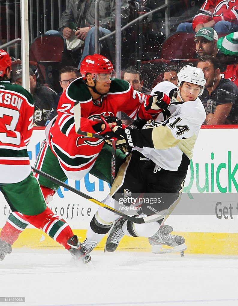 <a gi-track='captionPersonalityLinkClicked' href=/galleries/search?phrase=Bryce+Salvador&family=editorial&specificpeople=208746 ng-click='$event.stopPropagation()'>Bryce Salvador</a> #24 of the New Jersey Devils checks <a gi-track='captionPersonalityLinkClicked' href=/galleries/search?phrase=Chris+Kunitz&family=editorial&specificpeople=604159 ng-click='$event.stopPropagation()'>Chris Kunitz</a> #14 of the Pittsburgh Penguins during the game at the Prudential Center on March 17, 2012 in Newark, New Jersey.