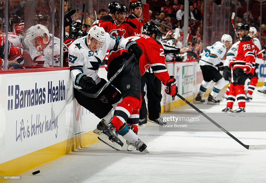<a gi-track='captionPersonalityLinkClicked' href=/galleries/search?phrase=Bryce+Salvador&family=editorial&specificpeople=208746 ng-click='$event.stopPropagation()'>Bryce Salvador</a> #24 of the New Jersey Devils checks <a gi-track='captionPersonalityLinkClicked' href=/galleries/search?phrase=Tommy+Wingels&family=editorial&specificpeople=5807738 ng-click='$event.stopPropagation()'>Tommy Wingels</a> #57 of the San Jose Sharks into the boards during the first period at the Prudential Center on October 18, 2014 in Newark, New Jersey.