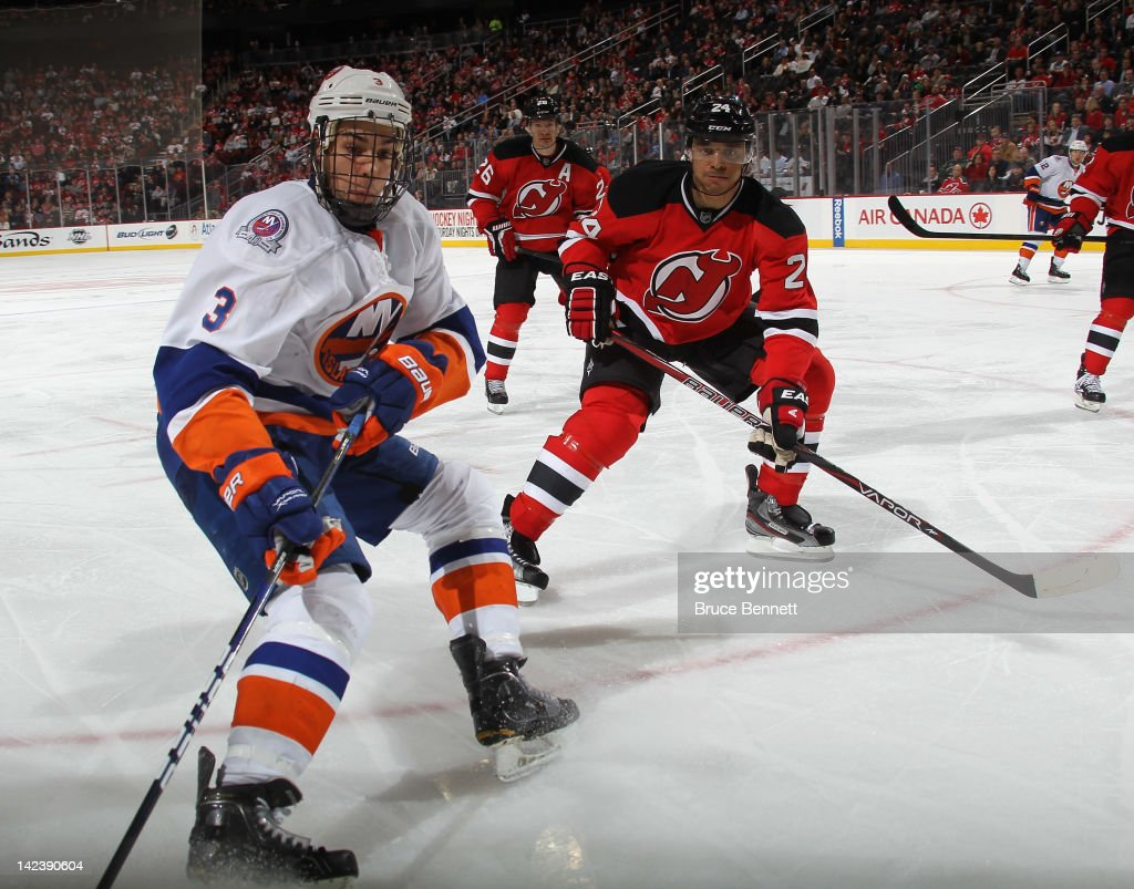 <a gi-track='captionPersonalityLinkClicked' href=/galleries/search?phrase=Bryce+Salvador&family=editorial&specificpeople=208746 ng-click='$event.stopPropagation()'>Bryce Salvador</a> #24 of the New Jersey Devils checks <a gi-track='captionPersonalityLinkClicked' href=/galleries/search?phrase=Travis+Hamonic&family=editorial&specificpeople=4605791 ng-click='$event.stopPropagation()'>Travis Hamonic</a> #3 of the New York Islanders at the Prudential Center on April 3, 2012 in Newark, New Jersey. The Devils defeated the Islanders 3-1.