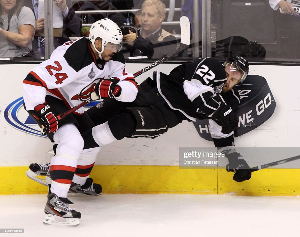 <a gi-track='captionPersonalityLinkClicked' href=/galleries/search?phrase=Bryce+Salvador&family=editorial&specificpeople=208746 ng-click='$event.stopPropagation()'>Bryce Salvador</a> #24 of the New Jersey Devils checks <a gi-track='captionPersonalityLinkClicked' href=/galleries/search?phrase=Trevor+Lewis&family=editorial&specificpeople=543187 ng-click='$event.stopPropagation()'>Trevor Lewis</a> #22 of the Los Angeles Kings in Game Four of the 2012 Stanley Cup Final at Staples Center on June 6, 2012 in Los Angeles, California.