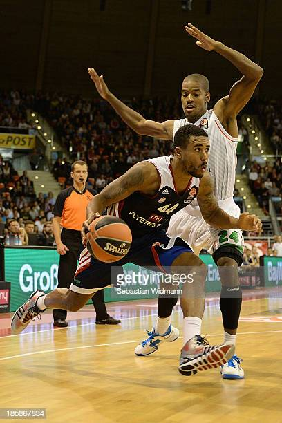 Bryce Taylor #44 of FC Bayern Munich competes with Kim English #24 of Montepaschi Siena during the 20132014 Turkish Airlines Euroleague Regular...