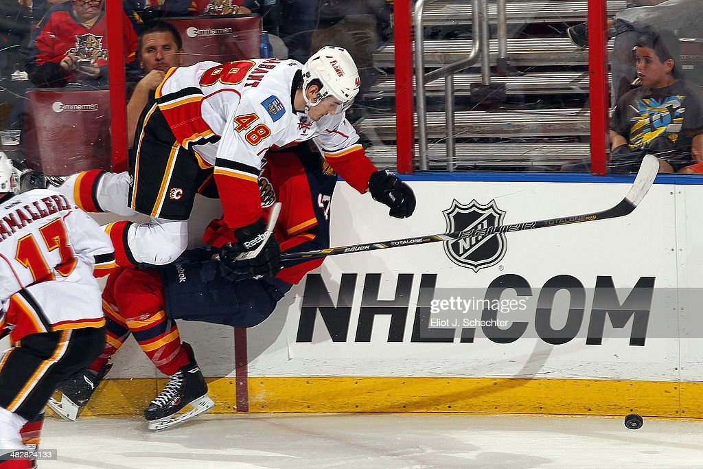 Bryce Van Brabant #48 of the Calgary Flames collides with <a gi-track='captionPersonalityLinkClicked' href=/galleries/search?phrase=Colby+Robak&family=editorial&specificpeople=4898162 ng-click='$event.stopPropagation()'>Colby Robak</a> #47 of the Florida Panthers at the BB&T Center on April 4, 2014 in Sunrise, Florida.