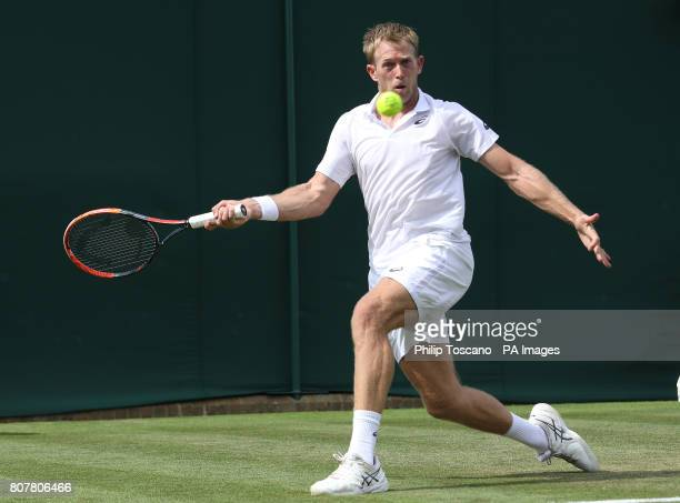 Brydan Klein in action against Yuichi Sugita on day two of the Wimbledon Championships at the All England Lawn Tennis and Croquet Club Wimbledon