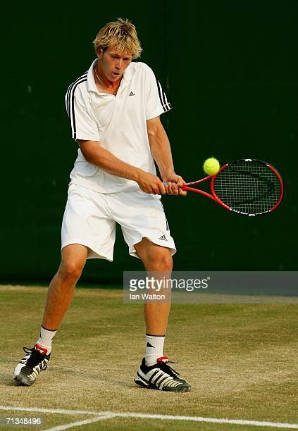 Brydan Klein of Australia returns a backhand to Dennis Lajola of the United States during day six of the Wimbledon Lawn Tennis Championships at the...