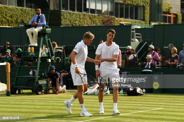 Brydan Klein of Great Britain and Joe Salisbury of Great Britain react during the Gentlemen's Doubles first round match against Ken Skupski of Great...