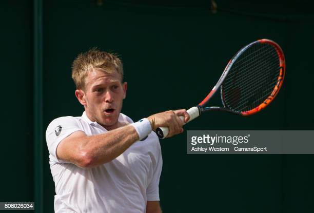 Brydan Klein of Great Britain in action during his defeat by Yuchi Sugita of Japan in their Men's Singles First Round Match at Wimbledon on July 4...