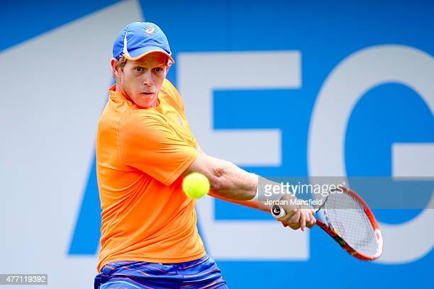 Brydan Klein of Great Britain plays a backhand during his Qualification match of the Aegon Championships against PaulHenri Mathieu of France at...