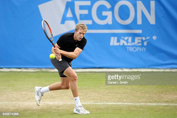 Brydan Klein of Great Britain plays a backhand during his match against Grega Zamlja of Slovakia during the Aegon Ilkley Trophy at Ilkley Lawn Tennis...