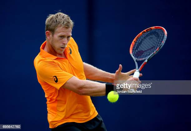Brydan Klein of Great Britain plays a backhand during his Men's singles first round match against Alex de Minaur of Australia during day two of the...