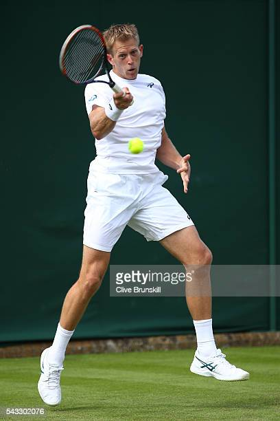 Brydan Klein of Great Britain plays a backhand shot during the Men's Singles first round against Nicolas Mahut on day one of the Wimbledon Lawn...