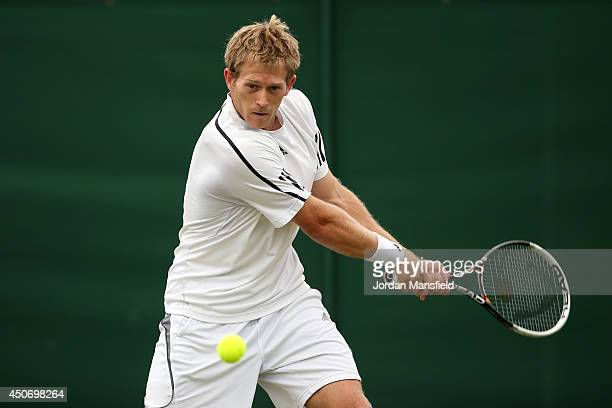 Brydan Klein of Great Britain plays a forehand during his first round qualifying match against Maxime Authom of Belgium on day one of the Wimbledon...