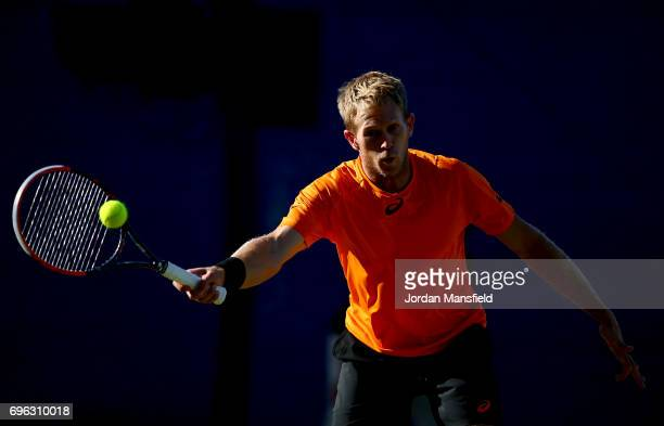 Brydan Klein of Great Britain plays a forehand during his Men's Singles second round match against Sam Groth of Australia during day four of the...