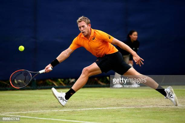 Brydan Klein of Great Britain reaches for a forehand during his Men's singles first round match against Alex de Minaur of Australia during day two of...
