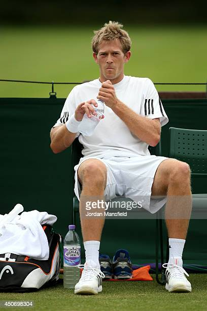 Brydan Klein of Great Britain sits in his chair during his first round qualifying match against Maxime Authom of Belgium on day one of the Wimbledon...