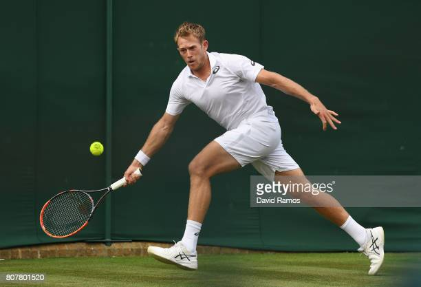 Brydan Klein of Great Britian plays a forehand during the Gentlemen's Singles first round match against Yuichi Sugita of Japan on day two of the...