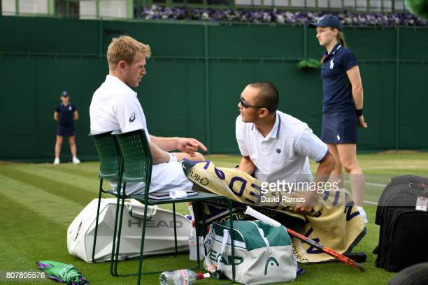 Brydan Klein of Great Britian receives treatment from the medical team during the Gentlemen's Singles first round match against Yuichi Sugita of...