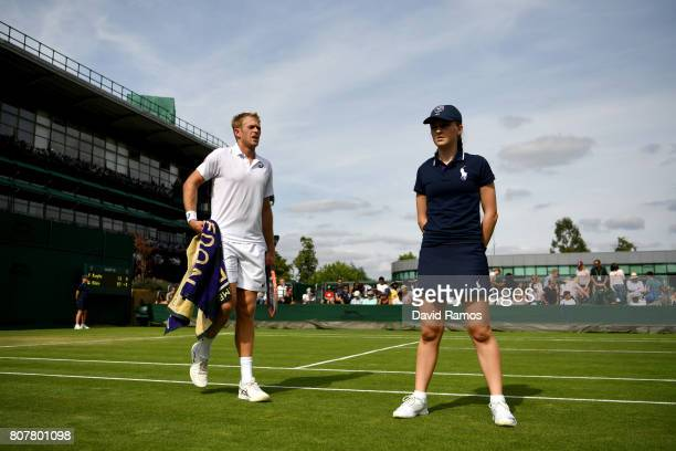Brydan Klein of Great Britian walks onto the court prior to the Gentlemen's Singles first round match against Yuichi Sugita of Japan on day two of...