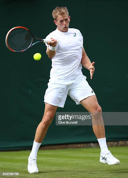 Brydan Klein of Great BVritain plays a forehand shot during the Men's Singles first round against Nicolas Mahut on day one of the Wimbledon Lawn...