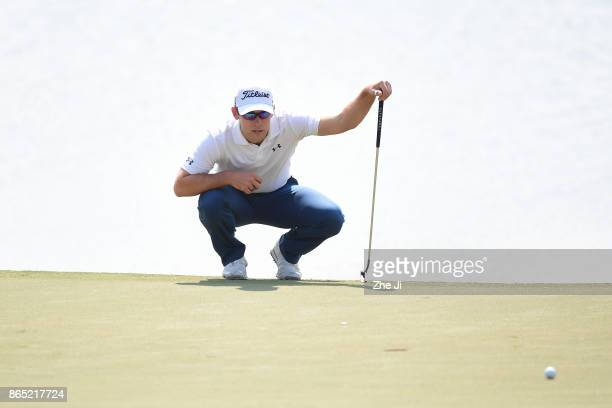 Bryden Macpherson of Australia lines up a putt during the final round of the 2017 Foshan Open at the Foshan Golf Club on October 22 2017 in Foshan...