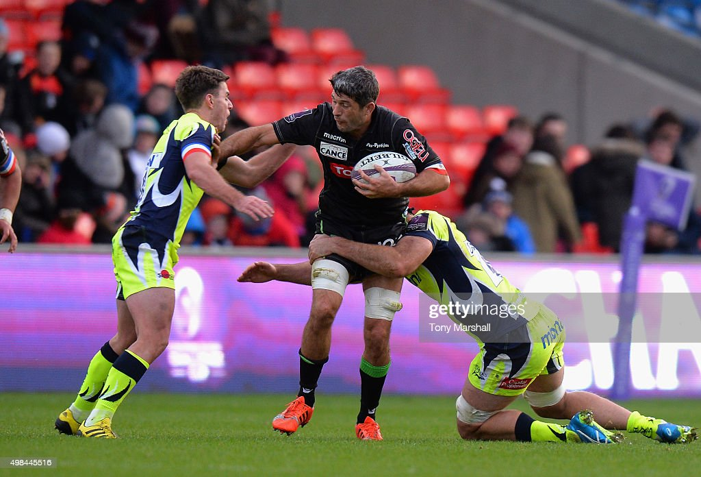 Bryn Evans of Sale Sharks tackles <a gi-track='captionPersonalityLinkClicked' href=/galleries/search?phrase=Jean+Bouilhou&family=editorial&specificpeople=572048 ng-click='$event.stopPropagation()'>Jean Bouilhou</a> of Pau during the European Rugby Challenge Cup match between Sale Sharks and Pau at AJ Bell Stadium on November 21, 2015 in Salford, England.