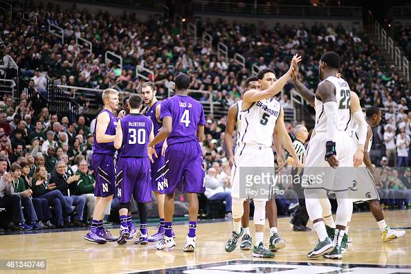 Bryn Forbes and Branden Dawson of the Michigan State Spartans celebrate during the game against the Northwestern Wildcats at the Breslin Center on...