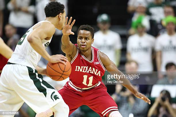 Bryn Forbes of the Michigan State Spartans handles the ball under pressure from Yogi Ferrell of the Indiana Hoosiers in the first half at the Breslin...