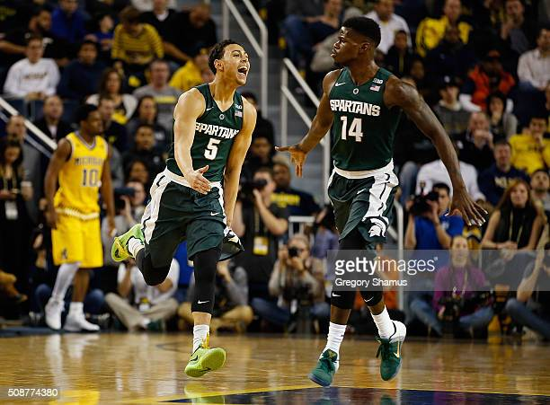 Bryn Forbes of the Michigan State Spartans reacts after a first half three point basket with teammate Eron Harris while playing the Michigan...