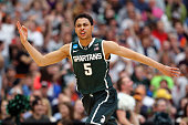 Bryn Forbes of the Michigan State Spartans reacts to a three pointer in the second half of the game against the Louisville Cardinals during the East...