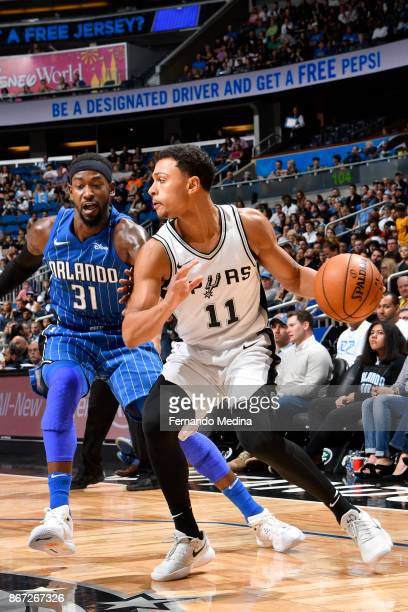 Bryn Forbes of the San Antonio Spurs handles the ball against Terrence Ross of the Orlando Magic on October 27 2017 at Amway Center in Orlando...