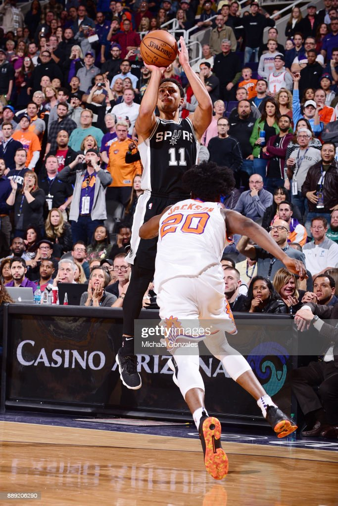 Bryn Forbes #11 of the San Antonio Spurs shoots a 3-pointer against the Phoenix Suns on December 9, 2017 at Talking Stick Resort Arena in Phoenix, Arizona.