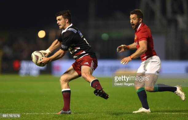 Bryn Gatland of NZ Provincial Barbarians passes the ball as Greig Laidlaw of the British Irish Lions closes in during the 2017 British Irish Lions...