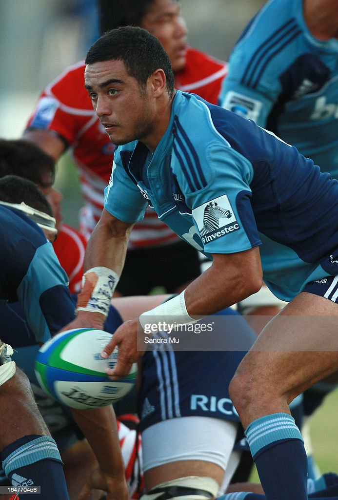 Bryn Hall of the Blues looks to pass during the Pacific Rugby Cup match between the Blues Development and Junior Japan at Bell Park on March 28, 2013 in Auckland, New Zealand.