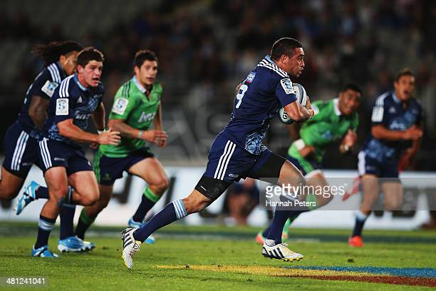 Bryn Hall of the Blues makes a break during the round seven Super Rugby match between the Blues and the Highlanders at Eden Park on March 29 2014 in...