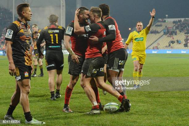 Bryn Hall of the Crusaders and his team mates celebrate scoring a try during the Super Rugby Semi Final match between the Crusaders and the Chiefs at...