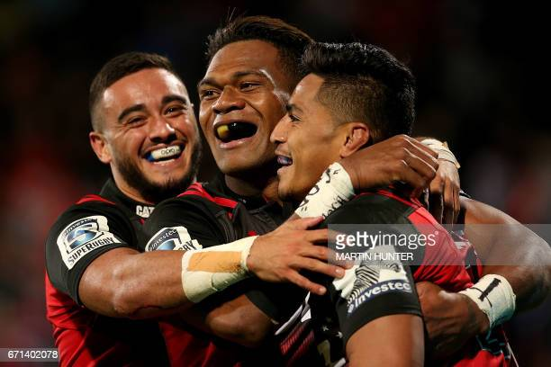 Bryn Hall Seta Tamanivalu and Pete Samu all of the Canterbury Crusaders celebrate after scoring a try during the Super Rugby match between New...