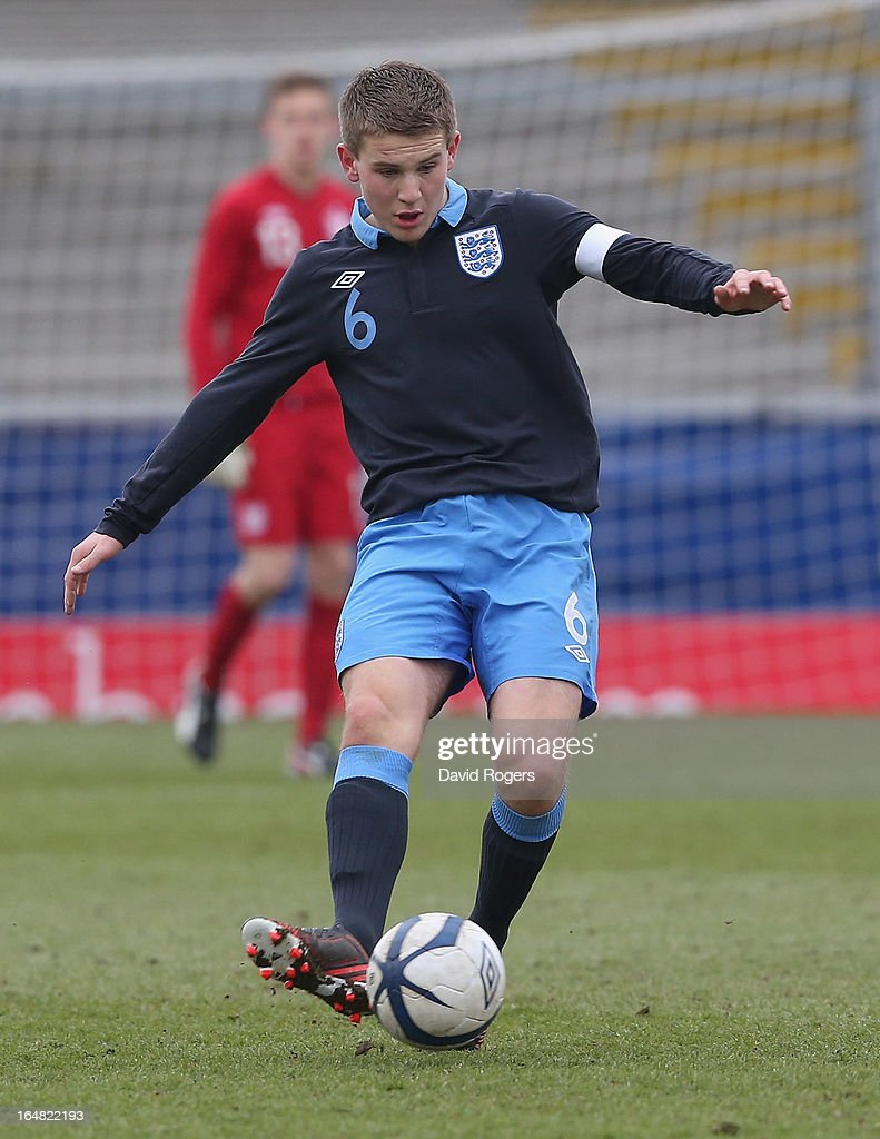 Bryn Morris of England passes the ball during the UEFA European Under 17 Championship match between England and Slovenia at Pirelli Stadium on March 28, 2013 in Burton-upon-Trent, England.