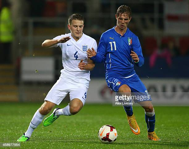 Bryn Morris of England U19 and Luca Vido of Italy U19 challenge for the ball during the International friendly match between England U19 and Italy...
