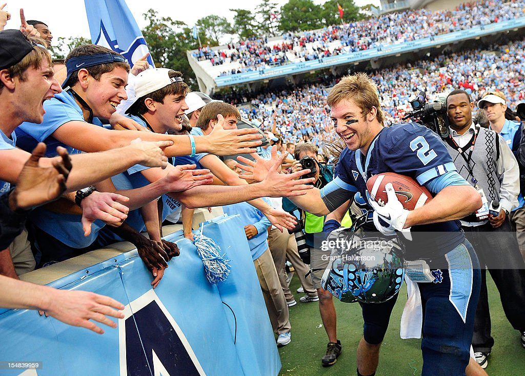 Bryn Renner #2 of the North Carolina Tar Heels celebrates with students after a win over the North Carolina State Wolfpack at Kenan Stadium on October 27, 2012 in Chapel Hill, North Carolina. North Carolina won 43-35.