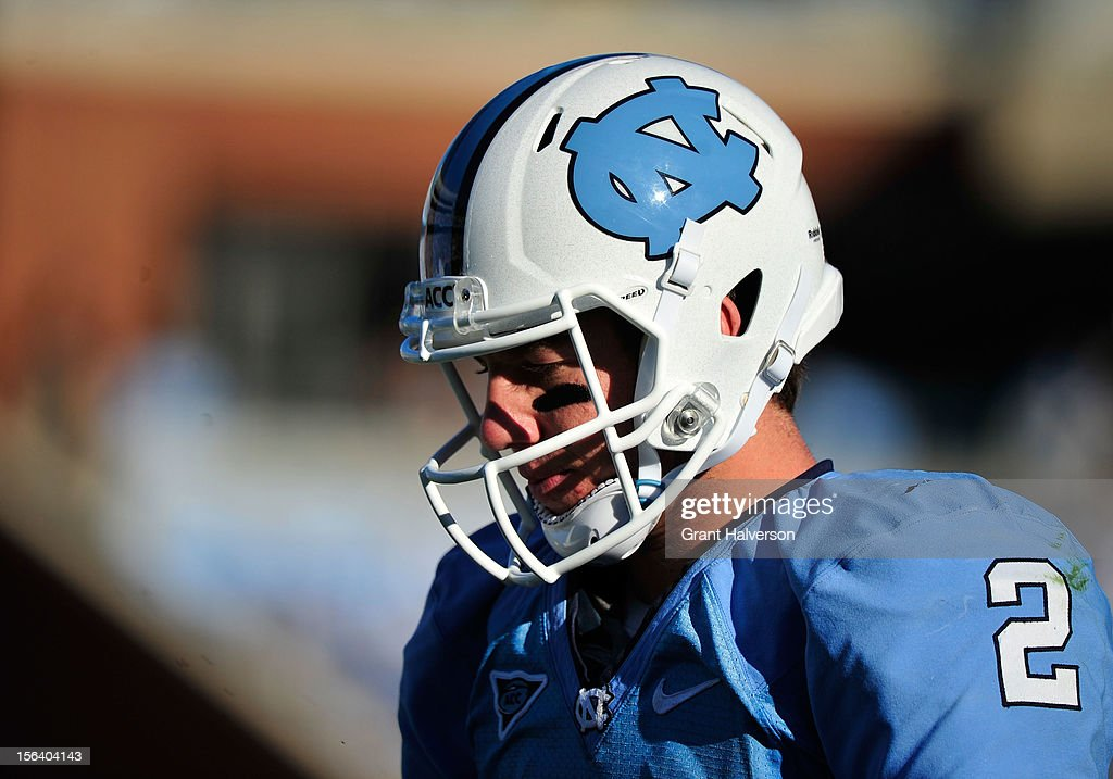 <a gi-track='captionPersonalityLinkClicked' href=/galleries/search?phrase=Bryn+Renner&family=editorial&specificpeople=6786211 ng-click='$event.stopPropagation()'>Bryn Renner</a> #2 of the North Carolina Tar Heels walks off the field after a turnover against the Georgia Tech Yellow Jackets during play at Kenan Stadium on November 10, 2012 in Chapel Hill, North Carolina. Georgia Tech won 68-50.