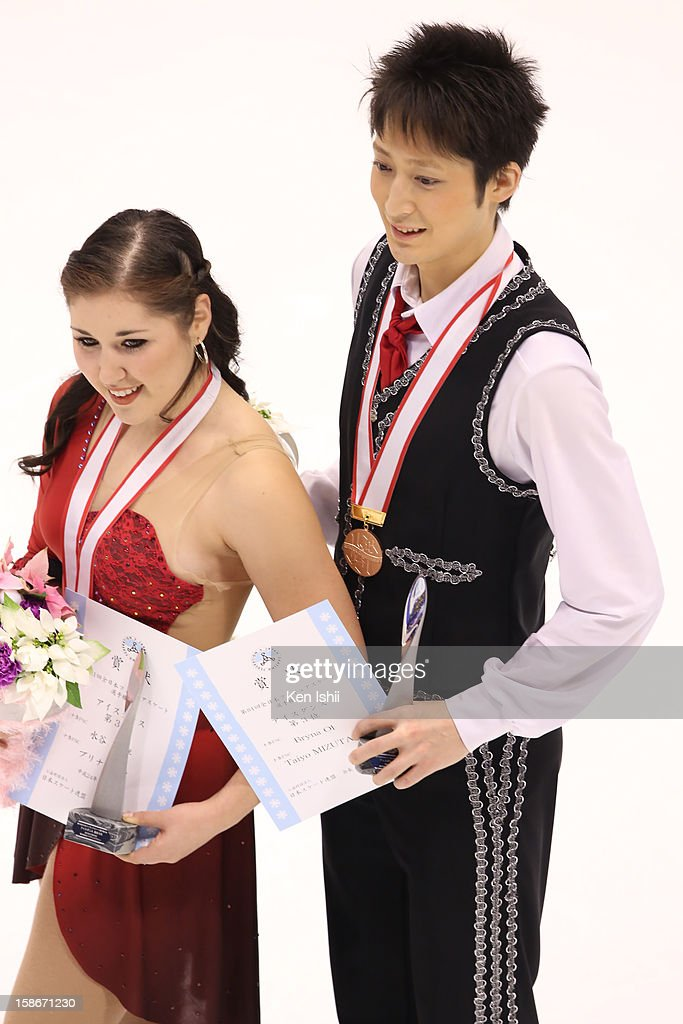 Bryna Oi (L) and Taiyo Mizutani pose for photographs after the medal ceremony during day three of the 81st Japan Figure Skating Championships at Makomanai Sekisui Heim Ice Arena on December 23, 2012 in Sapporo, Japan.