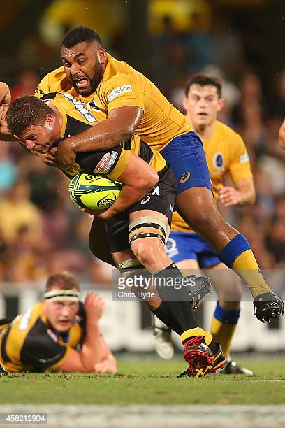 Brynard Stander of Perth Spirit is tackled by Pettowa Paraka of Brisbane City during the 2014 NRC Grand Final match between Brisbane City and Perth...