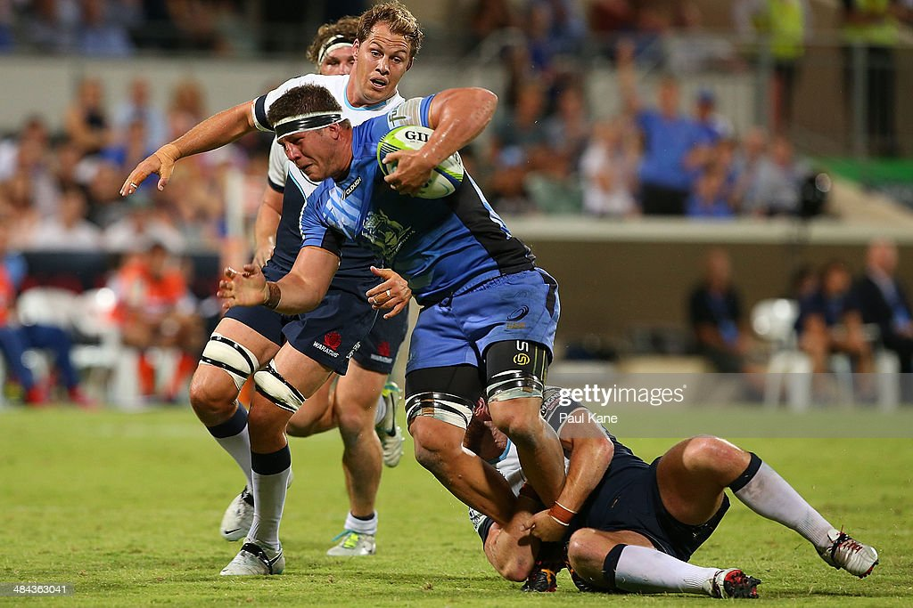 Brynard Stander of the Force gets tackled during the round nine Super Rugby match between the Force and the Waratahs at nib Stadium on April 12, 2014 in Perth, Australia.