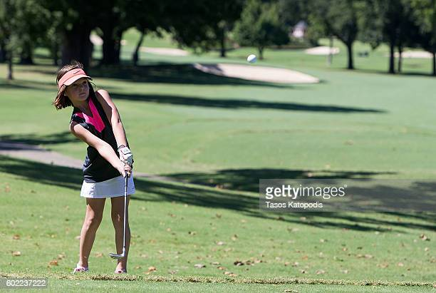 Brynn Bowman chips in the girls 79 at the Drive Chip and Putt Regional Qualifier at Southern Hills Country Club on September 10 2016 in Tulsa Oklahoma