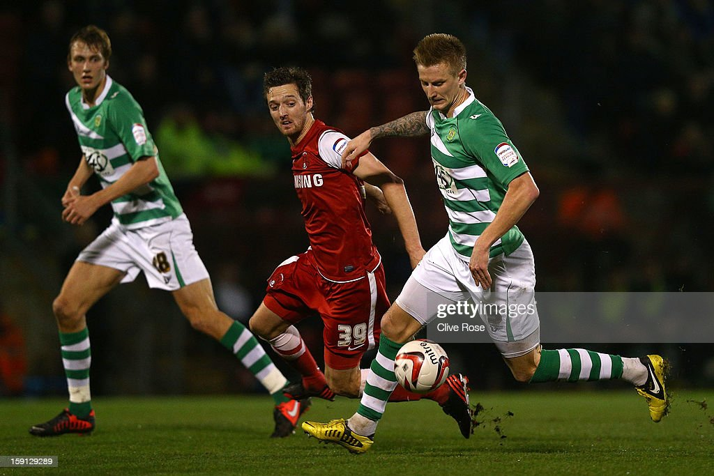 Bryon Webster of Yeovil Town is challenged by David Mooney of Leyton Orient during the Johnstone's Paint Trophy southern section semi final between Leyton Orient and Yeovil Town at the Matchroom Stadium on January 8, 2013 in London, England.