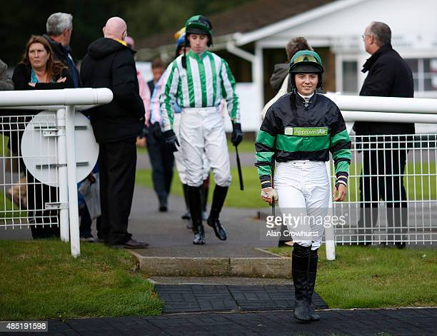 Bryony Frost enters the parade ring at Fontwell racecourse on August 25 2015 in Fontwell England