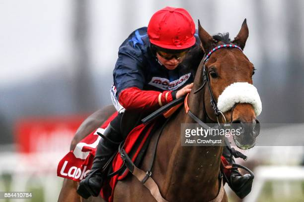 Bryony Frost riding Old Guard clear the last to win The Ladbrokes Handicap Hurdle Race at Newbury racecourse on December 2 2017 in Newbury United...