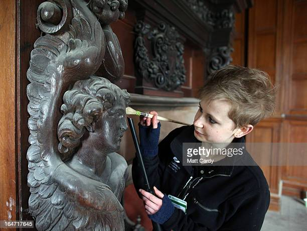 Bryony Lee conservation assistant cleans carvings around a fireplace which is are on display for the first time this century in a recently restored...