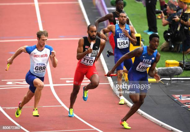 Bryshon Nellum hands the baton to Michael Cherry of the United States in the Men's 4x400 Metres Relay heats during day nine of the 16th IAAF World...