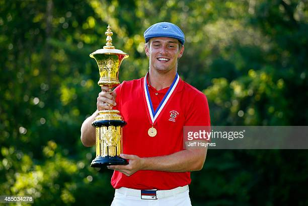 Bryson DeChambeau holds the Theodore A Havemeyer trophy after beating Derek Bard 76 during the final match of the US Amateur Championship at Olympia...