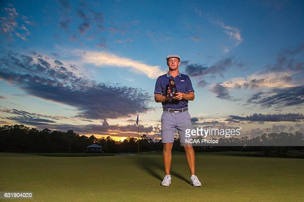 Bryson Dechambeau of Southern Methodist University holds his trophy on the 18th green of the Concession Golf Club in Bradenton Florida after winning...